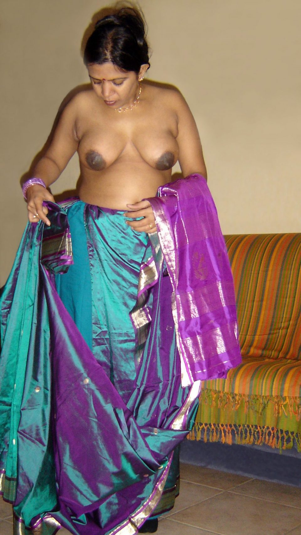 Nude women in sarees something