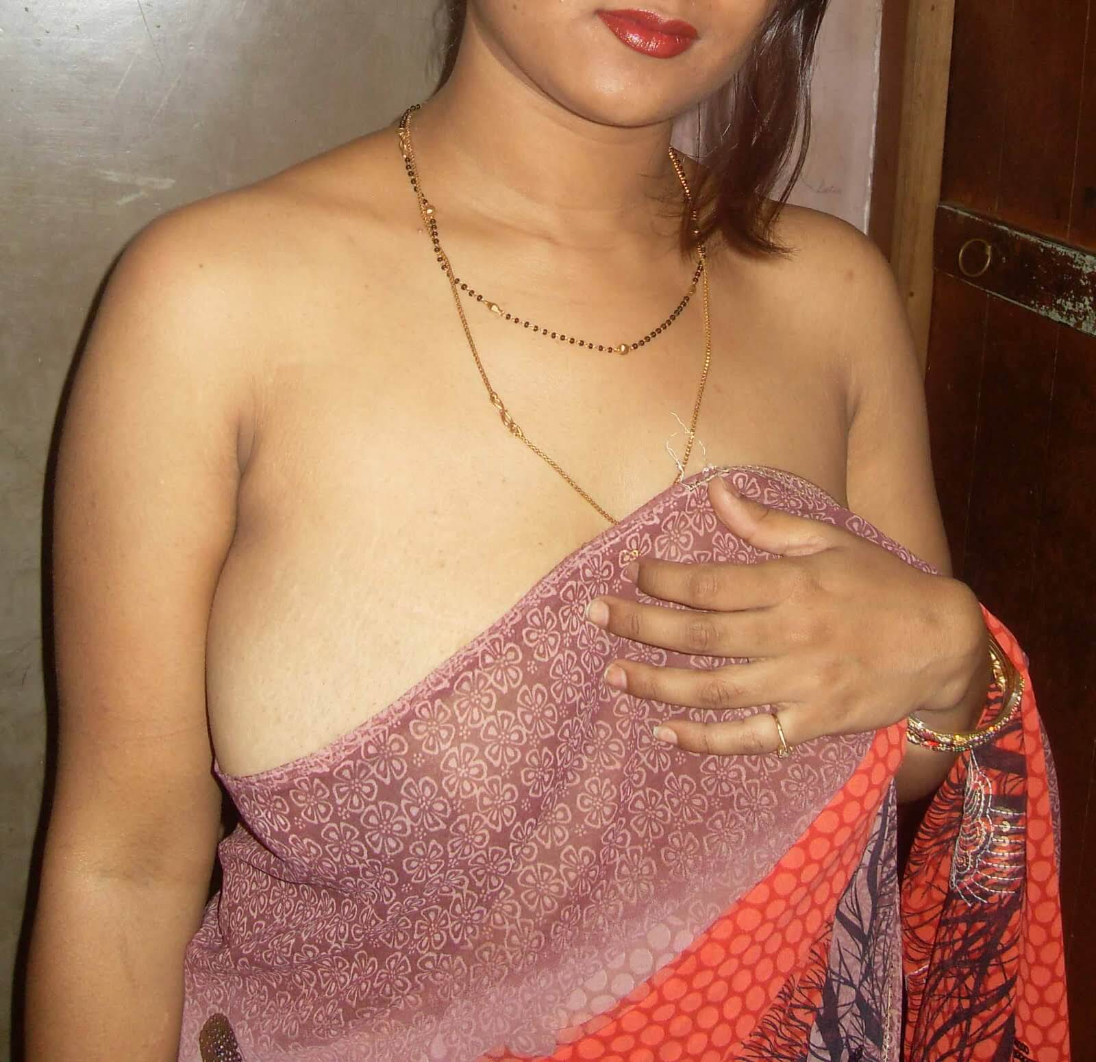Indian desi bhabhi wearing transparent blouse and showing bra