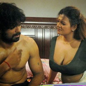 Indian aunty removing blouse image